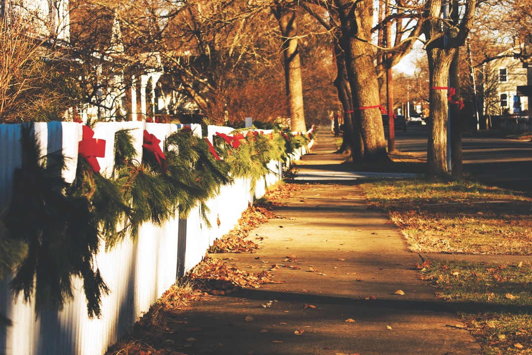 Giving back weekly series sidewalk with evergreen boughs image